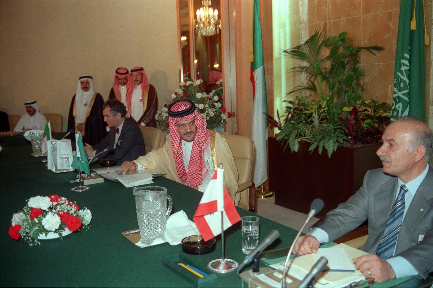 Sitting between Lebanese Parliament speaker Hussain al-Hussaini (R) and Algerian Foreign Minister Ahmad Ghassali (L), Saudi Arabian Foreign Minister Prince Saul al-Faysal (C) looks on 30 September 1989 in Taif after the members of Lebanese National Assembly started to discuss the charter of national reconciliation. The session was attended by 31 Christian and 31 Muslim MP's. At a further meeting 22 October 1989, the charter of national reconciliation (the Taif Agreement) was endorsed by 58 of the 62 deputies attending the session. The Taif agreement provided for the transfer of executive power from the presidency to a cabinet, with portfolios divided equally among Christian and Muslim ministers. (Photo by NABIL ISMAIL / AFP)