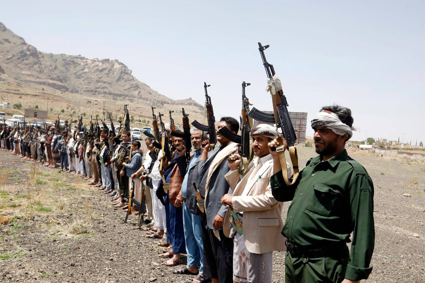 epa09215483 Armed Houthi supporters take part in a rally protesting against Israeli strikes on the Gaza Strip, in Sana'a, Yemen, 20 May 2021. In response to days of violent confrontations between Israeli security forces and Palestinians in Jerusalem, various Palestinian militant factions in Gaza launched rocket attacks since 10 May that killed at least ten Israelis to date. Gaza Strip's health ministry said that at least 232 Palestinians, including 65 children, were killed in the recent retaliatory Israeli airstrikes.  EPA/YAHYA ARHAB