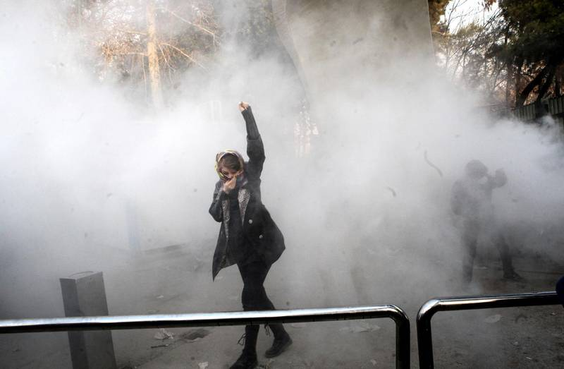 epaselect epa06410380 Iranian students clash with riot police during an anti-government protest around the University of Tehran, Iran, 30 December 2017. Media reported that illegal protest against the government is going on in most of the cities in Iran. Protests were held in at least nine cities, including Tehran, against the economic and foreign policy of President Hassan Rouhani's government.  EPA/STR