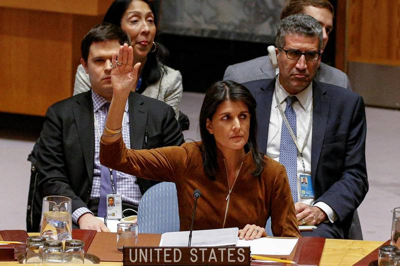 U.S. Ambassador to the United Nations Nikki Haley votes for a bid to renew an international inquiry into chemical weapons attacks in Syria, during a meeting of the U.N. Security Council at the United Nations headquarters in New York, U.S., November 17, 2017.  REUTERS/Brendan McDermid
