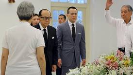 Outpouring of grief as Singapore bids farewell to patriarch