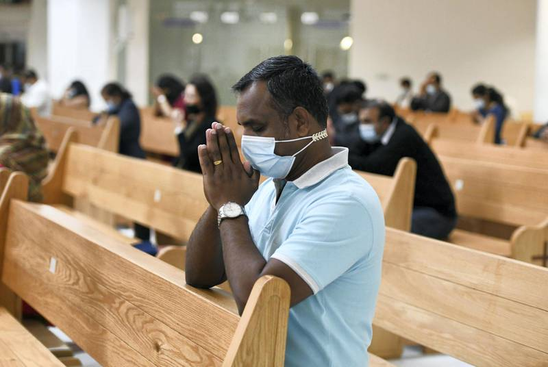 Abu Dhabi, United Arab Emirates - Worshippers must follow safety guidelines at St. PaulÕs Catholic Church in Mussafah. Khushnum Bhandari for The National