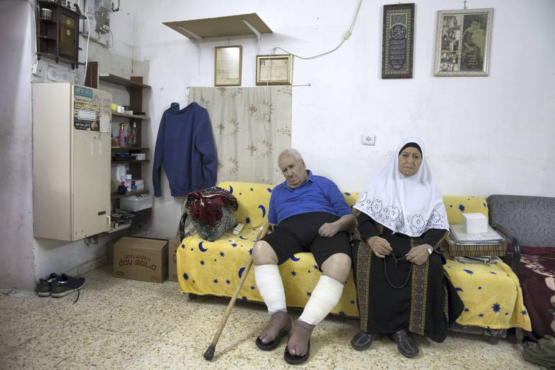 Ayoub and Fahima Shamasneh in their basement home in the East Jerusalem neighborhood of Sheik Jarrah on August 11,2017.  When the Shamasne family first moved into their home  in the 1960s, East Jerusalem was controlled by Jordan and their monthly rent was paid to  Jordanian authorities but since  Israel annexed East Jerusalem in 1967, the Shamasne family has paid their rent to Israel's general custodian in order to remain in the building. The family claims that their payments were suddenly rejected in 2009 , and they were informed that the property had been claimed by Israeli Jews whose ancestors had lived there decades previously.Although the family has spent years fighting to remain in the home , the Israeli high court has ruled that the family must evacuate the home before August 9. (Photo by Heidi Levine for The National).