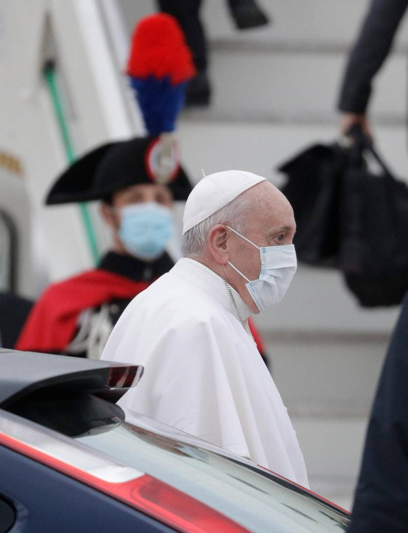 Pope Francis prepares to leave from Fiumicino's International airport Leonardo da Vinci, near Rome, for Baghdad, Iraq, Friday, March 5, 2021. Pope Francis is bound to Iraq for a four-day visit to urge the country's dwindling number of Christians to stay put and help rebuild the country after years of war and persecution, brushing aside the coronavirus pandemic and security concerns to make the first-ever papal visit. (AP Photo/Gregorio Borgia).
