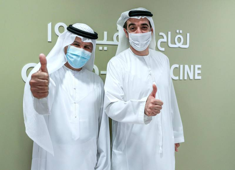 Abu Dhabi, United Arab Emirates, December 13, 2020.   Doctors and UAE residents get Covid-19 vaccinated at the Burjeel Hospital, Al Najdah Street, Abu Dhabi.  Jaber Humaid, left and Omran Al Khoori after getting their vaccinations at the clinic.Victor Besa/The NationalSection:  NA