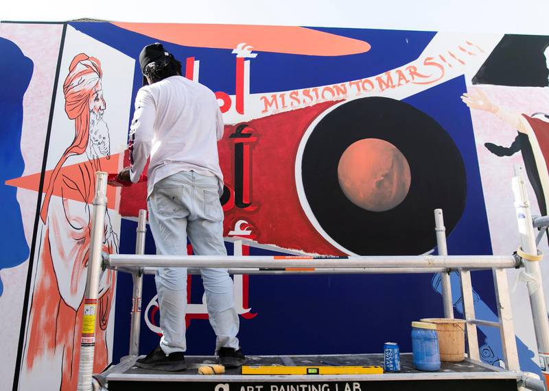 """DUBAI, UNITED ARAB EMIRATES. 25 JULY 2020. Artists Amna Basheer and Reem Al Mazrouei work on their commission for Dubai Culture. They are painting a """"Hope mural"""" to celebrate the UAE Mars mission in Dubai's Al Fahidi district. (Photo: Reem Mohammed/The National)Reporter:Section:"""