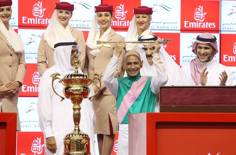 DUBAI , UNITED ARAB EMIRATES – March 25 , 2017 :  Arrogate  ( USA ) number  ( 9 ) ridden by  Mike Smith won the 9th horse race Dubai World Cup 2000m ( dirt ) at the Meydan Racecourse in Dubai. Sheikh Hamdan Bin Rashid Al Maktoum , Deputy ruler of Dubai is also seen in the photo on left. ( Pawan Singh / The National ) For News. Story by Amith Passela. ID No - 76600 *** Local Caption ***  PS2503- DWC59.jpg