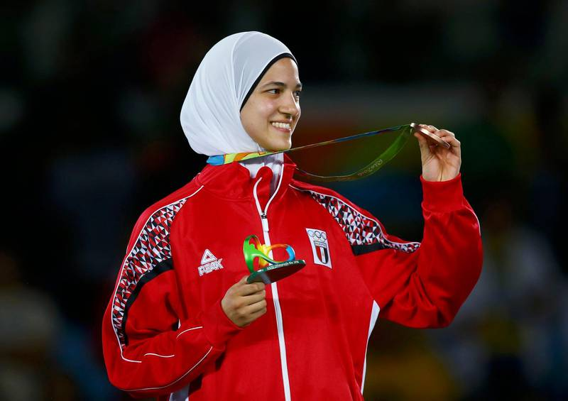 2016 Rio Olympics - Taekwondo -Women's -57kg Victory Ceremony - Carioca Arena 3 - Rio de Janeiro, Brazil - 18/08/2016. Hedaya Malak Wahba (EGY) of Egypt celebrates on the podium with her bronze medals.   REUTERS/Peter Cziborra (BRAZIL  - Tags: SPORT OLYMPICS SPORT TAEKWONDO) FOR EDITORIAL USE ONLY. NOT FOR SALE FOR MARKETING OR ADVERTISING CAMPAIGNS.     Picture Supplied by Action Images