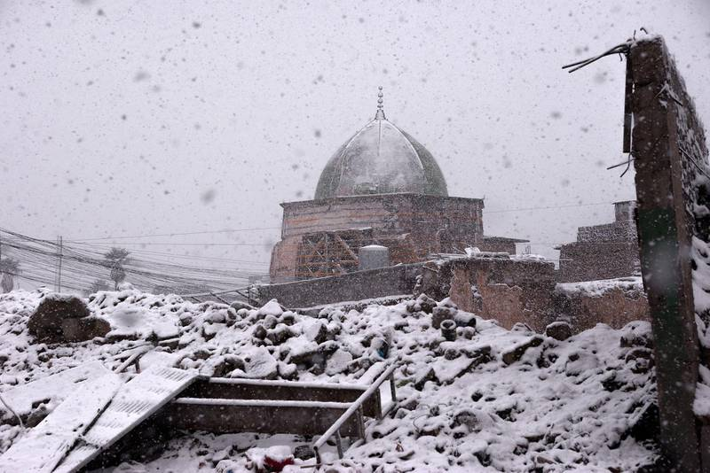 This picture taken on February 10, 2020 amidst a heavy snow storm shows a view of the dome of the Nuri mosque in the old town of Iraq's northern city Mosul, at the site heavily damaged by Islamic State (IS) group fighters in the 2017 battle for the city.  / AFP / Zaid AL-OBEIDI