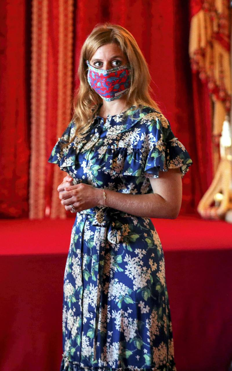 Britain's Princess Beatrice of York stands alongside her wedding dress (not pictured), which was originally worn by Britain's Queen Elizabeth in the 1960s, ahead of it going on public display at Windsor Castle, Windsor, Britain, September 23, 2020. Steve Parsons/PA Wire/Pool via REUTERS