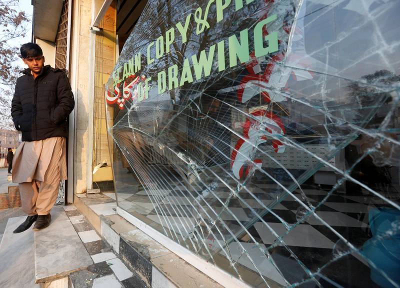 An Afghan shopkeeper looks at the broken glass window of his shop near the site of a bomb attack in Kabul, Afghanistan, January 28, 2018. REUTERS/Omar Sobhani
