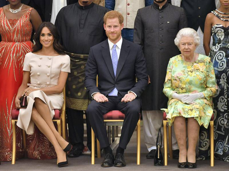 LONDON, ENGLAND - JUNE 26: Meghan, Duchess of Sussex, Prince Harry, Duke of Sussex and Queen Elizabeth II at the Queen's Young Leaders Awards Ceremony at Buckingham Palace on June 26, 2018 in London, England. The Queen's Young Leaders Programme, now in its fourth and final year, celebrates the achievements of young people from across the Commonwealth working to improve the lives of people across a diverse range of issues including supporting people living with mental health problems, access to education, promoting gender equality, food scarcity and climate change.  (Photo by John Stillwell - WPA Pool/Getty Images)