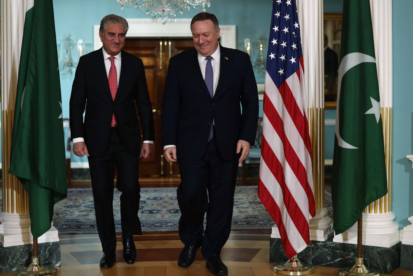 WASHINGTON, DC - JANUARY 17: U.S. Secretary of State Mike Pompeo waves as he welcomes Pakistani Foreign Minister Shah Mehmood Qureshi at the State Department January 17, 2020 in Washington, DC. The two counterparts met to discuss bilateral issues. Foreign Minister Shah Mehmood Qureshi has expressed his support of continued American engagement in Afghanistan for rebuilding efforts.   Alex Wong/Getty Images/AFP == FOR NEWSPAPERS, INTERNET, TELCOS & TELEVISION USE ONLY ==
