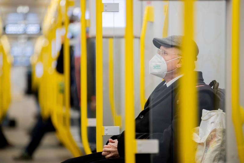A man sits in the subway wearing an FFP2 mask in Berlin, Germany, Wednesday, Jan. 20, 2021.. During the federal-state talks on the measures against the Corona pandemic, some rules were tightened. For example, the more protective FFP2 masks or surgical masks must be worn on buses and trains and when shopping. The federal states decide for themselves when the new rules will apply. (Christoph Soeder/dpa via AP)
