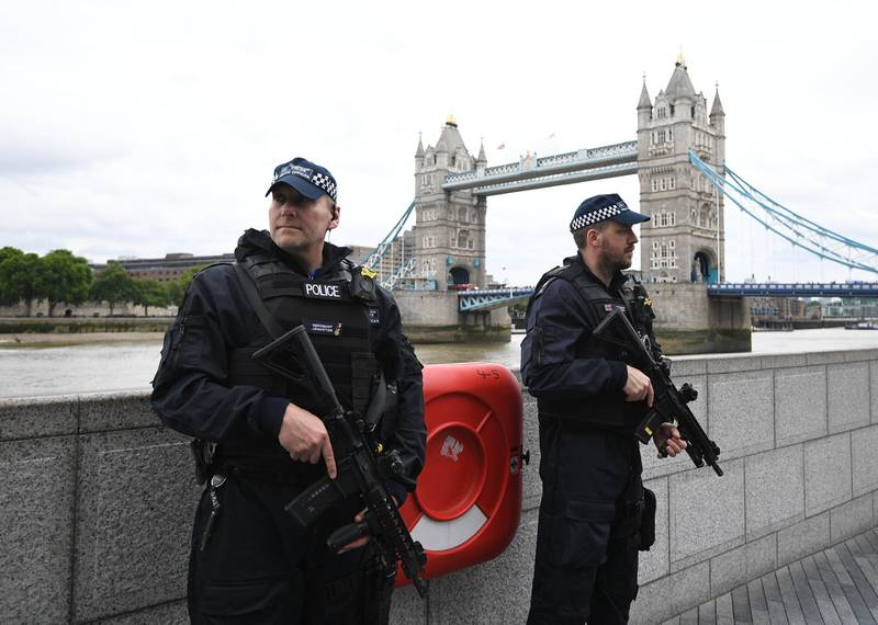 epa06369453 (FILE) - British police on dutyl during a vigil for the victims of the London Bridge terror attacks by the City Hall in London, Britain, 05 June 2017, (reissued 05 December 2017). Media reports on 05 December 2017 state that the report by David Anderson QC, a former terrorism law reviewer asked by the British Home Secretary to audit internal MI5 and police reviews, is published on 05 December 2017. The terror attacks in 2017 - at Manchester Arena, London Bridge, Finsbury Park and Westminster - has placed the spotlight on the British security services. The British internal security service MI5 and police launched internal reviews following the atrocities between March and June 2017 and the findings of the reviews looking at intelligence handling by the organisations are to be seen in the review published by the  Home Secretary.  EPA/FACUNDO ARRIZABALAGA *** Local Caption *** 53568746