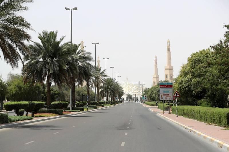 Al Ain, United Arab Emirates - Reporter: N/A: A quiet street leads to Sheikh Khalifa bin Zayed Grand mosque in Al Ain. Thursday, April 9th, 2020. Al Ain. Chris Whiteoak / The National