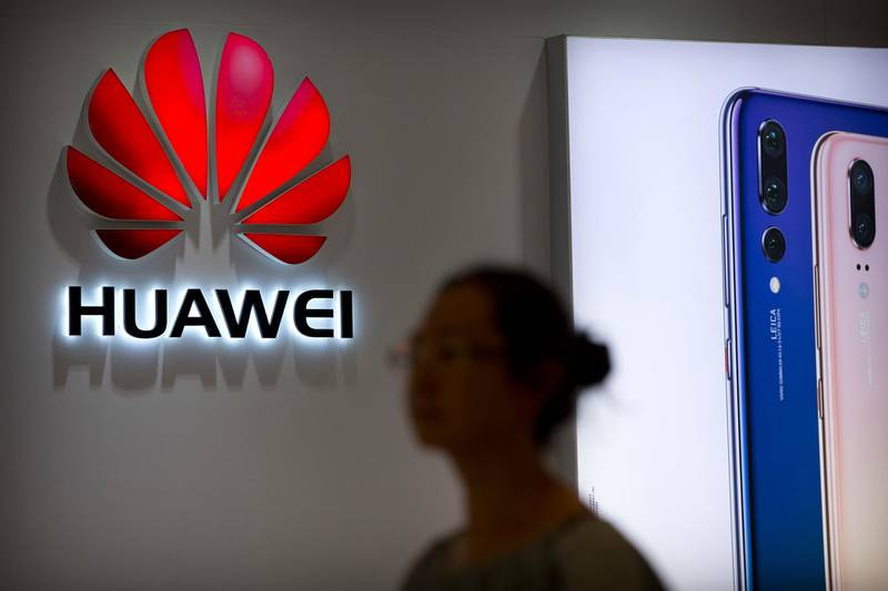 A shopper walks past a Huawei store at a shopping mall in Beijing Wednesday, July 4, 2018. China has produced success stories including Huawei Technologies Ltd., the biggest global seller of switching gear for phone companies and the No. 3 smartphone brand. The company has developed its own Kirin line of chip sets to power some of its phones, reducing reliance on U.S.-based Qualcomm Corp.'s Snapdragon and other foreign suppliers. (AP Photo/Mark Schiefelbein)