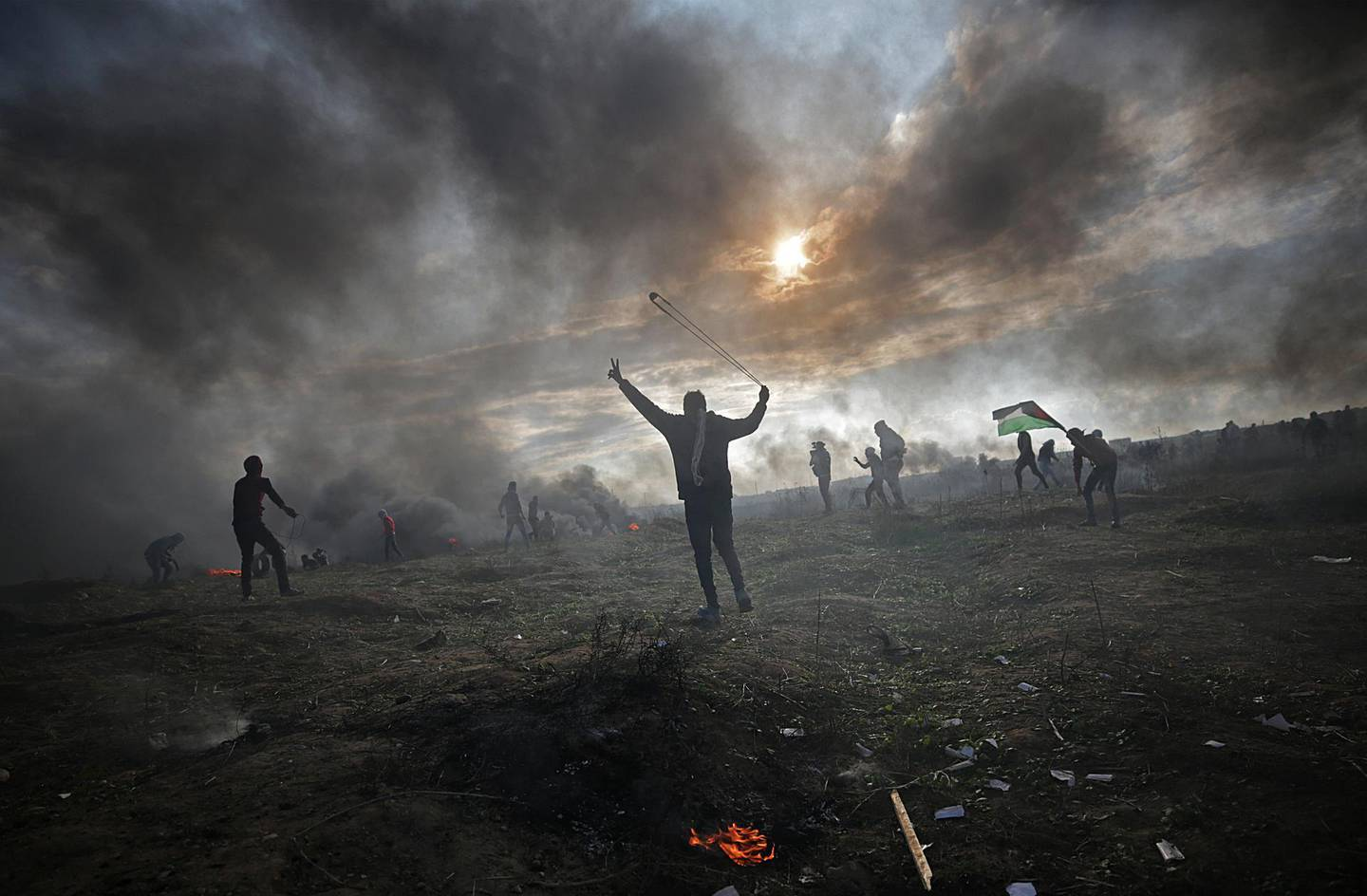 epa06392203 Palestinian protesters throw stones at Israeli troops during clashes near the border with Israel, against US President decision to recognize Jerusalem as the capital of Israel, in the east of Gaza City, 15 December 2017. Two Palestinians were killed during the clashes in the east of Gaza Strip. US president Donald J. Trump on 06 December announced he is recognizing Jerusalem as the Israel capital and will relocate the US embassy from Tel Aviv to Jerusalem.  EPA/MOHAMMED SABER