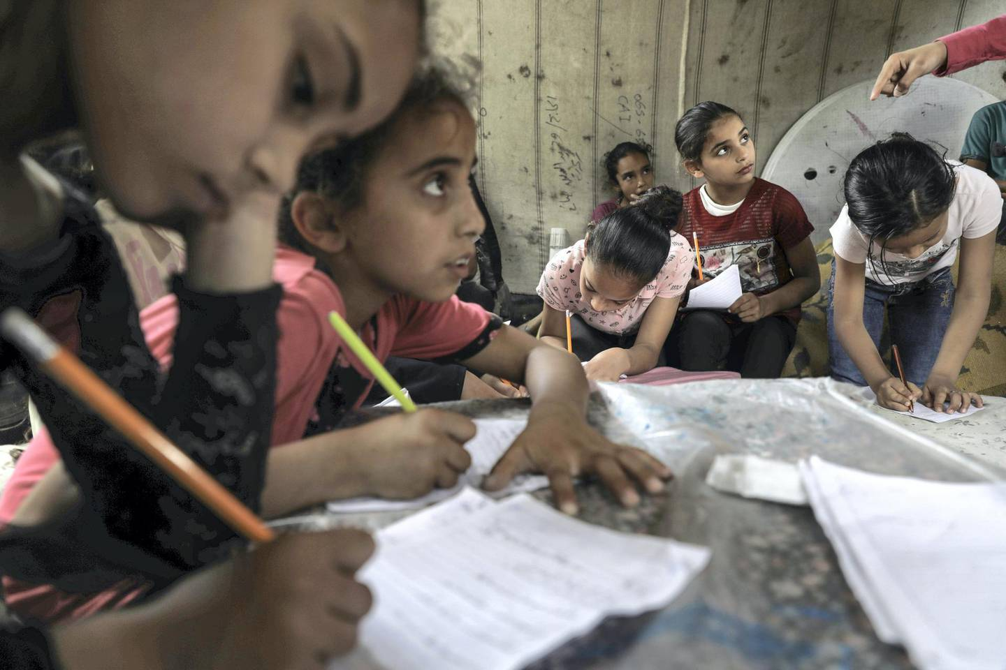 Children attend an Arabic language lesson given by a Palestinian school girl Fajr Hmaid, 13, as schools are shut due to the coronavirus disease (COVID-19) restrictions, at Hmaid's family house  in Gaza City,June 4, 2020.  (Photo by Majdi Fathi/NurPhoto via Getty Images)