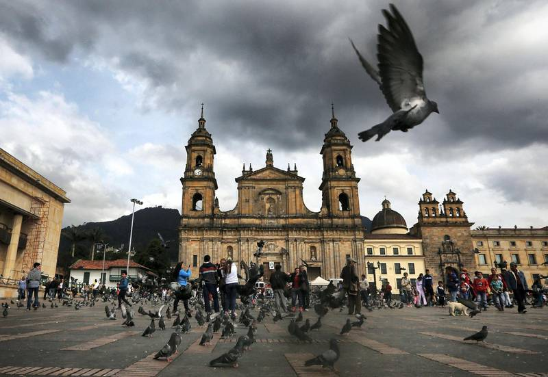 BOGOTA, COLOMBIA - OCTOBER 02:  A pigeon flies in Bolivar Square after Colombia's President Juan Manuel Santos cast his ballot there in the referendum on a peace accord to end the 52-year-old guerrilla war between the FARC and the state on October 2, 2016 in Bogota, Colombia. The guerrilla war is the longest-running armed conflict in the Americas and has left 220,000 dead. The plan called for a disarmament and re-integration of most of the estimated 7,000 FARC fighters. Colombians have voted to reject the peace deal in a very close vote. (Photo by Mario Tama/Getty Images)