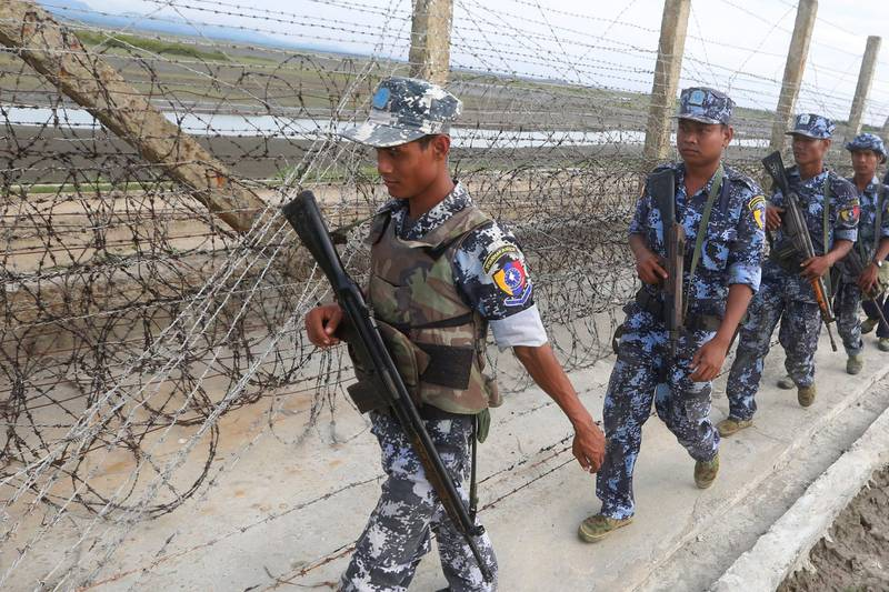 epa06574017 (FILE) - Myanmar border guard police officers patrol along a beach near a makeshift camp at the Myanmar-Bangladesh border, near the town of Maungsaw, Rakhine State, western Myanmar, 12 November 2017 (reissued 02 March 2018). According to media reports, the Myanmar military has defended on 02 March 2018, its decision to deploy fresh troops near the shared border with neighboring Bangladesh, blaming a militant threat. Earlier Dhaka asked Myanmar to pull back its soldiers from the border area near a refugee camp where more than 5,000 Rohingya refugees have been living. The Rohingya crisis started in August 2017, when Rohingya militants launched a series of attacks on multiple Myanmar government posts in the region, leading the army to unleash a large military campaign that drove around 700,000 Rohingyas across the border.  EPA/HEIN HTET