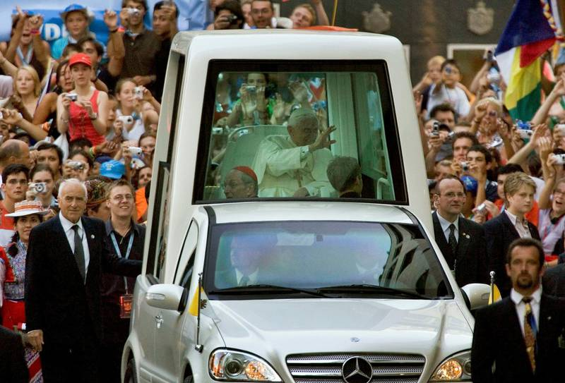 COLOGNE, GERMANY - AUGUST 18: Pope Benedict XVI  waves from his popemobile to the pilgrims in front of  the Cologne Cathedral on August 18, 2005 in Cologne, Germany. Thousands of young Catholics are arriving in Germany for the World Youth Day with Pope Benedict XVI, who will lead an open-air mass on August 21 which is expected to attract 800,000 worshippers from 193 countries. (Photo by Carsten Koall/Getty Images)