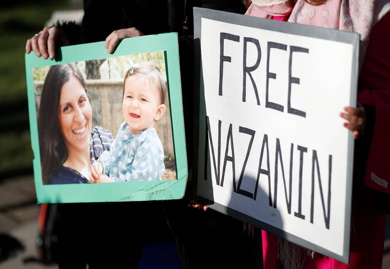 Demonstrators hold placards before a march in support of Nazanin Zaghari-Ratcliffe, the British-Iranian mother who is in jail in Iran, in London, Britain, November 25, 2017. REUTERS/Peter Nicholls NO RESALES. NO ARCHIVE