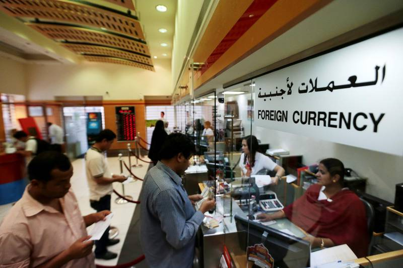 Abu Dhabi, United Arab Emirates, July 15, 2014:    Expatriates send funds to their home countries at the UAE Exchange at the Malabar Gold Building location in Abu Dhabi on July 15, 2014. Christopher Pike / The National  Reporter:  N/A Section: News