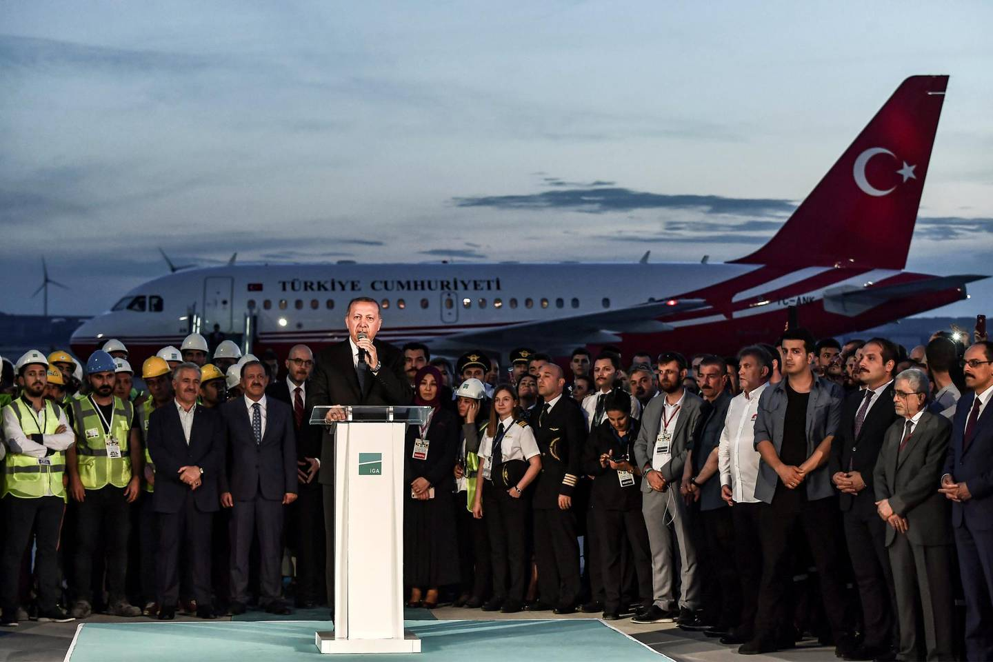 Turkish President Recep Tayyip Erdogan delivers a speech during a press conference following the first landing of his plane at the Istanbul New Airport, the third airport serving the city, located on the European side of Istanbul but on the Black Sea coast, on June 21, 2018. - The official inauguration ceremony of the Istanbul New Airport, which is set to become the world's largest once opened, is scheduled for October 29, 2018. (Photo by Aris MESSINIS / AFP)