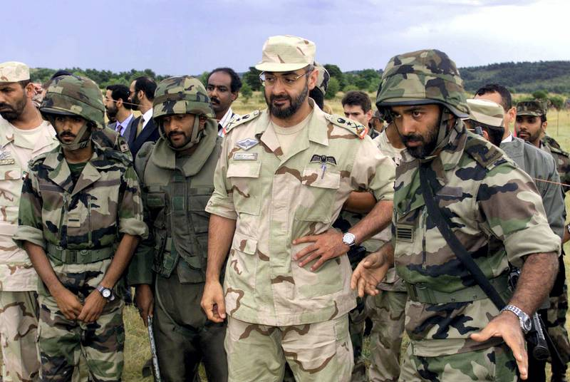 United Arab Emirates chief-of-staff Sheikh Mohamed Bin Zayed Al Nahayan (C) listens 08 July 1999 to UAE officers undergoing a training session in Canjuers, southern France, before going to Kosovo to join KFOR. (Photo by JACK DABAGHIAN / POOL / AFP)