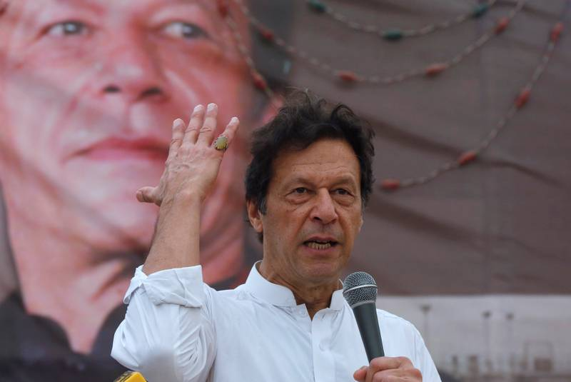 Imran Khan, chairman of the Pakistan Tehreek-e-Insaf (PTI), gestures while addressing his supporters during a campaign meeting ahead of general elections in Karachi, Pakistan, July 4, 2018. REUTERS/Akhtar Soomro