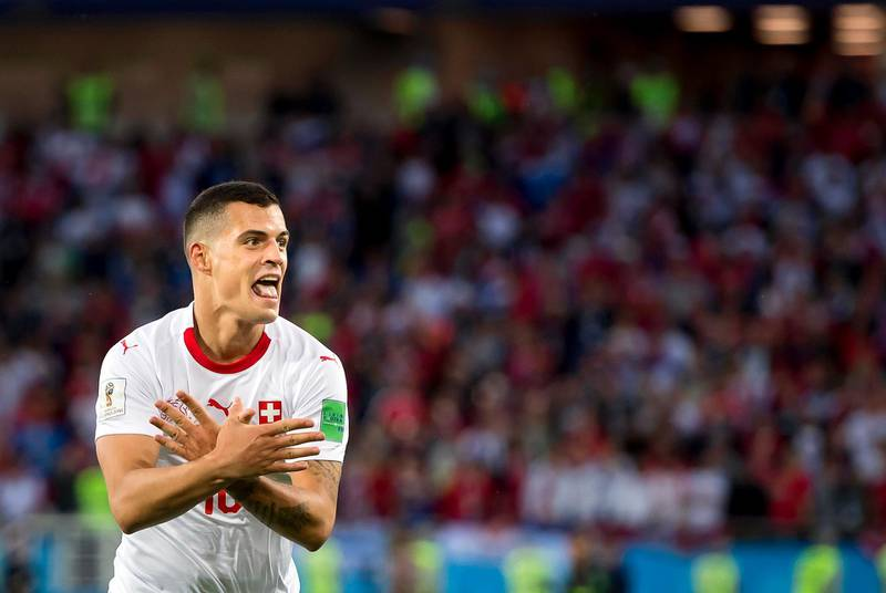 epa06831860 Switzerland's midfielder Granit Xhaka celebrates after scoring the 1-1 equalizer during the FIFA World Cup 2018 group E preliminary round soccer match between Switzerland and Serbia in Kaliningrad, Russia, 22 June 2018.   (RESTRICTIONS APPLY: Editorial Use Only, not used in association with any commercial entity - Images must not be used in any form of alert service or push service of any kind including via mobile alert services, downloads to mobile devices or MMS messaging - Images must appear as still images and must not emulate match action video footage - No alteration is made to, and no text or image is superimposed over, any published image which: (a) intentionally obscures or removes a sponsor identification image; or (b) adds or overlays the commercial identification of any third party which is not officially associated with the FIFA World Cup)  EPA/LAURENT GILLIERON   EDITORIAL USE ONLY
