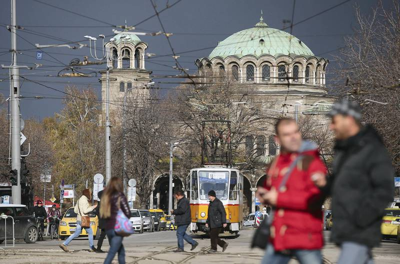 SOFIA, BULGARIA - DECEMBER 07:  People walk down the Vitosha Boulevard shopping street as the St Nedelya Eastern Orthodox church stands behind on December 7, 2013 in Sofia, Bulgaria. Restrictions on the freedom of Bulgarians and Romanians to work in the European Union are due to run out by December 31, though several EU leaders, including British Prime Minister David Cameron, are considering imposing temporary restrictions to cut the flow of Romanians and Bulgarians arriving in EU countries. Many EU nations have voiced concern over too many Bulgarians and Romanians arriving and applying for social benefits.  Romania and Bulgaria are both EU members though their citizens do not yet receive the same rights as citizens of other EU nations.  (Photo by Sean Gallup/Getty Images)
