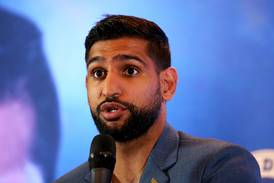 'Disgusted' Amir Khan claims he was removed from American Airlines flight 'for no reason'