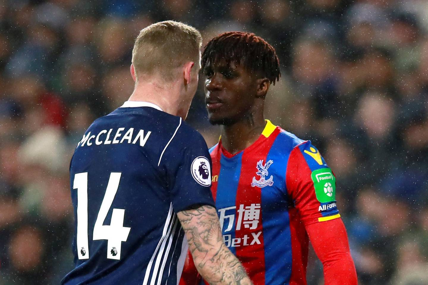 """Soccer Football - Premier League - West Bromwich Albion vs Crystal Palace - The Hawthorns, West Bromwich, Britain - December 2, 2017   Crystal Palace's Wilfried Zaha clashes with West Bromwich Albion's James McClean    Action Images via Reuters/Jason Cairnduff    EDITORIAL USE ONLY. No use with unauthorized audio, video, data, fixture lists, club/league logos or """"live"""" services. Online in-match use limited to 75 images, no video emulation. No use in betting, games or single club/league/player publications. Please contact your account representative for further details."""