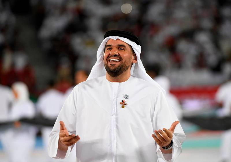 Emirati singer Hussain Al Jassmi performs during the opening ceremony for the 2019 AFC Asian Cup football competition prior to the game between United Arab Emirates and Bahrain at the Zayed sports city stadiuam in Abu Dhabi on January 05, 2019. / AFP / Khaled DESOUKI