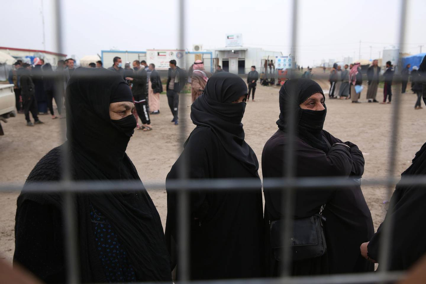 epa08889957 Iraqi Internally Displaced Persons (IDP) wait to get personal Identification cards and birth certificates for their children who were born under the rule of the Islamic State (IS) militants, at Hassan Sham camp for displaced people, east Mosul, Iraq, 17 December 2020. According to estimates, thousands of Iraqis who used to live in the areas ruled by the Islamic State militants between 2014 and 2017 are now seeking to issue official birth certificates for their children, Identification cards and marriage licenses that would allow them to get government services including health care and education.  EPA/GAILAN HAJI