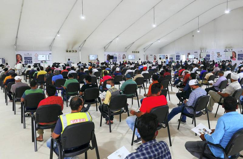 People getting their Covid vaccine at the SEHA Covid vaccination center at Dubai Parks and Resorts in Dubai on April 26,2021. (Pawan Singh/The National). Story by Nick Webster