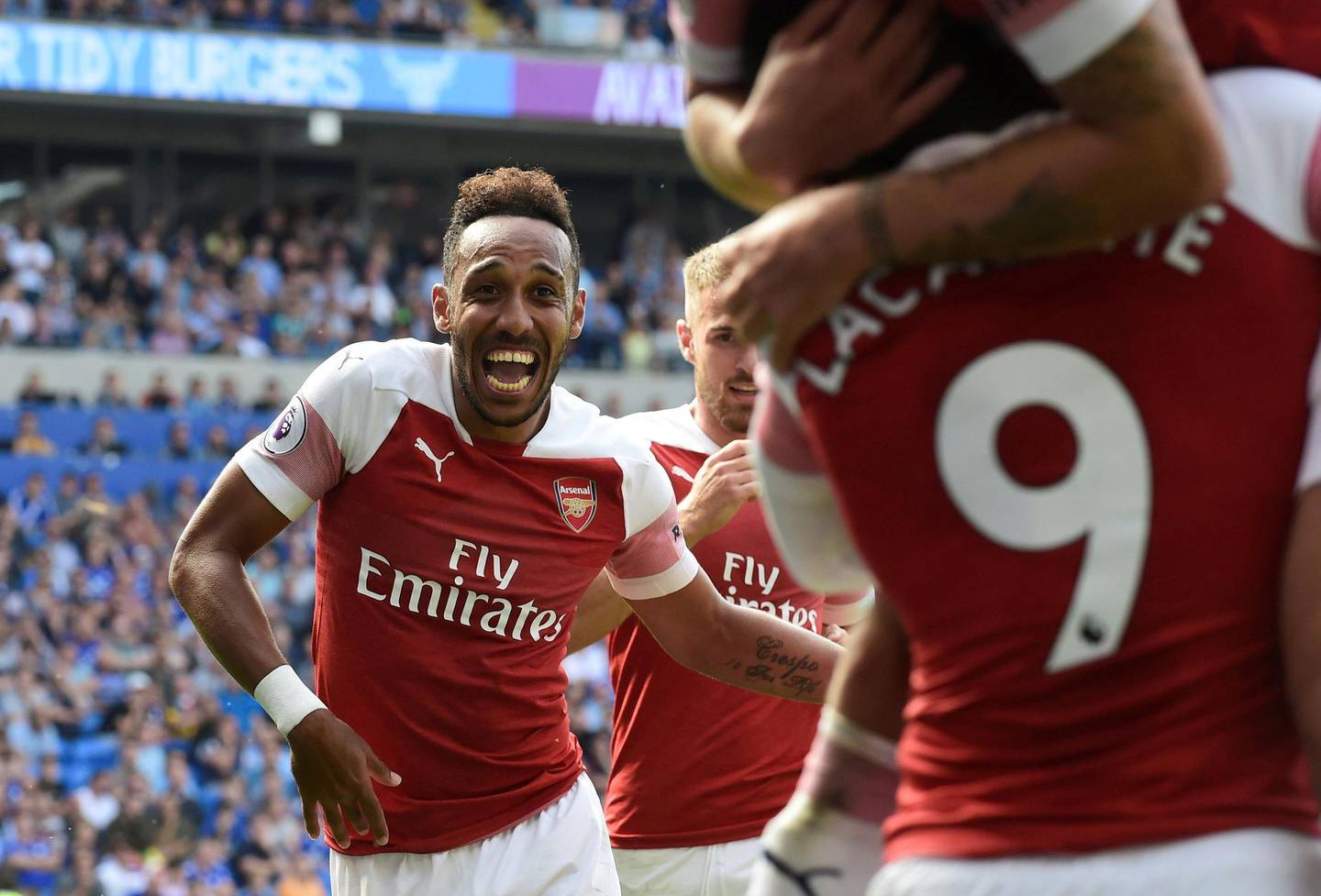 """Soccer Football - Premier League - Cardiff City v Arsenal - Cardiff City Stadium, Cardiff, Britain - September 2, 2018  Arsenal's Pierre-Emerick Aubameyang celebrates scoring their second goal              REUTERS/Rebecca Naden  EDITORIAL USE ONLY. No use with unauthorized audio, video, data, fixture lists, club/league logos or """"live"""" services. Online in-match use limited to 75 images, no video emulation. No use in betting, games or single club/league/player publications.  Please contact your account representative for further details.      TPX IMAGES OF THE DAY"""