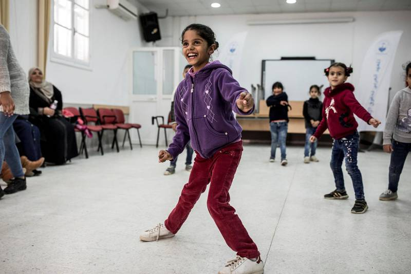 STRICTLY NO USE BEFORE 05:00 GMT (09:00 UAE) 18 JUNE 2020Six-year-old Syrian refugee, Sondes Younes, takes part in an interactive theatre activity run by UNHCR partner, the Arab Institute for Human Rights (IADH), with Tunisian and other refugee children from the Dar Saïda neighbourhood of Tunis. ; Once a month, the IADH organises activities for children aged between six and 15. The games and theatre workshops help the children meet, get to know each other and accept diversity in their community. Tunisia pursues an open-door policy for those fleeing neighbouring countries in fear of violence and persecution. Refugees and asylum-seekers can access public health services and education, with UNHCR's support, as well as child protection social services – although resources are a constraint. New arrivals to in Tunisia happen in the context of mixed population movements from neighbouring countries and from sub-Saharan Africa through regular and irregular entry points by air, land, sea or via sea rescues and interceptions. Half of the 3,000 refugees and asylum-seekers currently hosted in Tunisia come from Syria.
