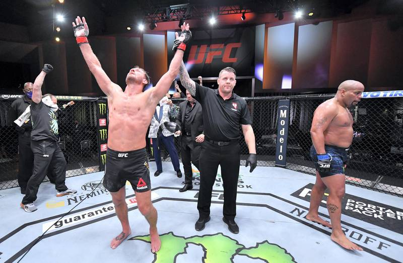LAS VEGAS, NEVADA - AUGUST 15: In this handout image provided by UFC, Stipe Miocic celebrates after his victory over Daniel Cormier in their UFC heavyweight championship bout during the UFC 252 event at UFC APEX on August 15, 2020 in Las Vegas, Nevada. (Photo by Jeff Bottari/Zuffa LLC via Getty Images)