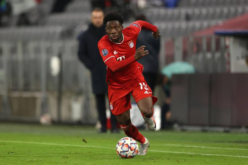 MUNICH, GERMANY - DECEMBER 09: Alphonso Davies of FC Bayern München runs with the ball during the UEFA Champions League Group A stage match between FC Bayern Muenchen and Lokomotiv Moskva at Allianz Arena on December 09, 2020 in Munich, Germany. (Photo by Alexander Hassenstein/Getty Images)