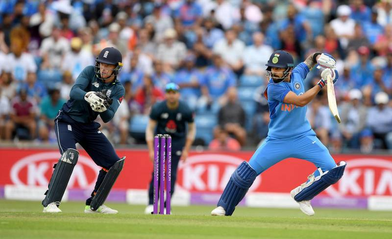 LEEDS, ENGLAND - JULY 17:  India batsman Virat Kohli hits out watched by Jos Buttler during 3rd ODI Royal London One Day match between England and India at Headingley on July 17, 2018 in Leeds, England.  (Photo by Stu Forster/Getty Images)