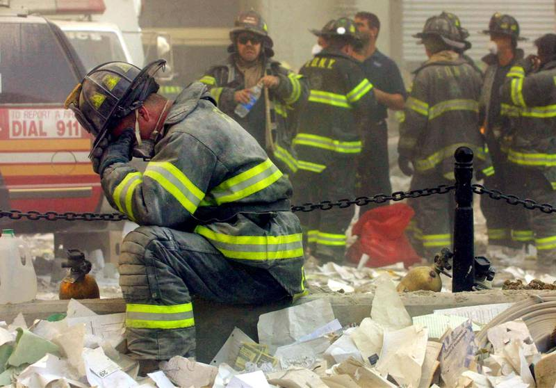 NEW YORK - SEPTEMBER 11, 2001: (SEPTEMBER 11 RETROSPECTIVE) A firefighter breaks down after the World Trade Center buildings collapsed September 11, 2001 after two hijacked airplanes slammed into the twin towers in a terrorist attack.   Mario Tama/Getty Images/AFP