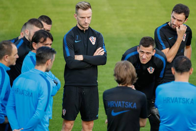 Croatia's midfielder Ivan Rakitic (C) and teammates attend a training session at a training field outside the Luzhniki Stadium in Moscow on July 13, 2018, two days before the Russia 2018 World Cup final football match between France and Croatia. / AFP / Odd ANDERSEN