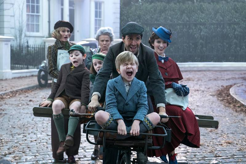 Jane (Emily Mortimer), John (Nathanael Saleh), Annabel (Pixie Davies, Ellen (Julie Walters), Jack (Lin-Manuel Miranda), Georgie (Joel Dawson) and Mary Poppins (Emily Blunt) in MARY POPPINS RETURNS, Disney���s original musical which takes audiences on an entirely new adventure with the practically-perfect nanny and the Banks family.
