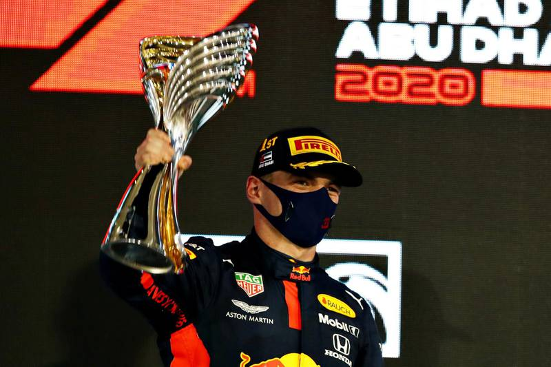 ABU DHABI, UNITED ARAB EMIRATES - DECEMBER 13: Race winner Max Verstappen of Netherlands and Red Bull Racing celebrates on the podium during the F1 Grand Prix of Abu Dhabi at Yas Marina Circuit on December 13, 2020 in Abu Dhabi, United Arab Emirates. (Photo by Mark Thompson/Getty Images)