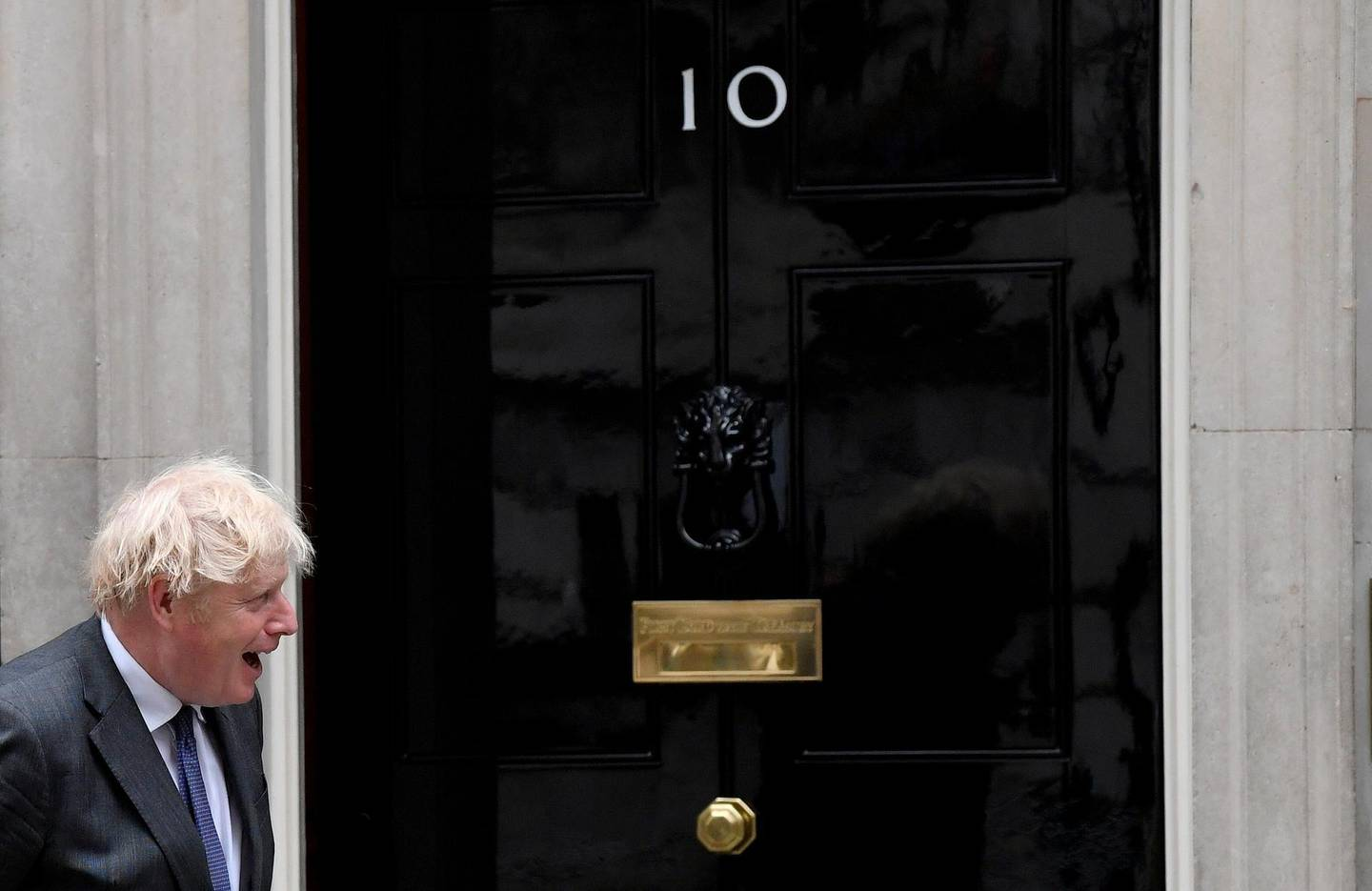 FILE PHOTO: Britain's Prime Minister Boris Johnson reacts in front of 10 at Downing Street, in London, Britain June 17, 2021. REUTERS/Toby Melville/File Photo