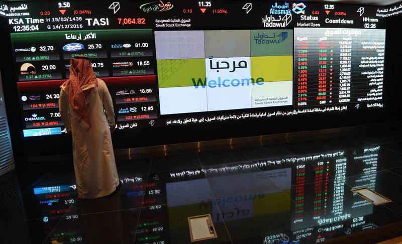A Saudi investor monitors the stock exchange at the Saudi Stock Exchange, or Tadawul, on December 14, 2016  in the capital Riyadh. / AFP PHOTO / FAYEZ NURELDINE