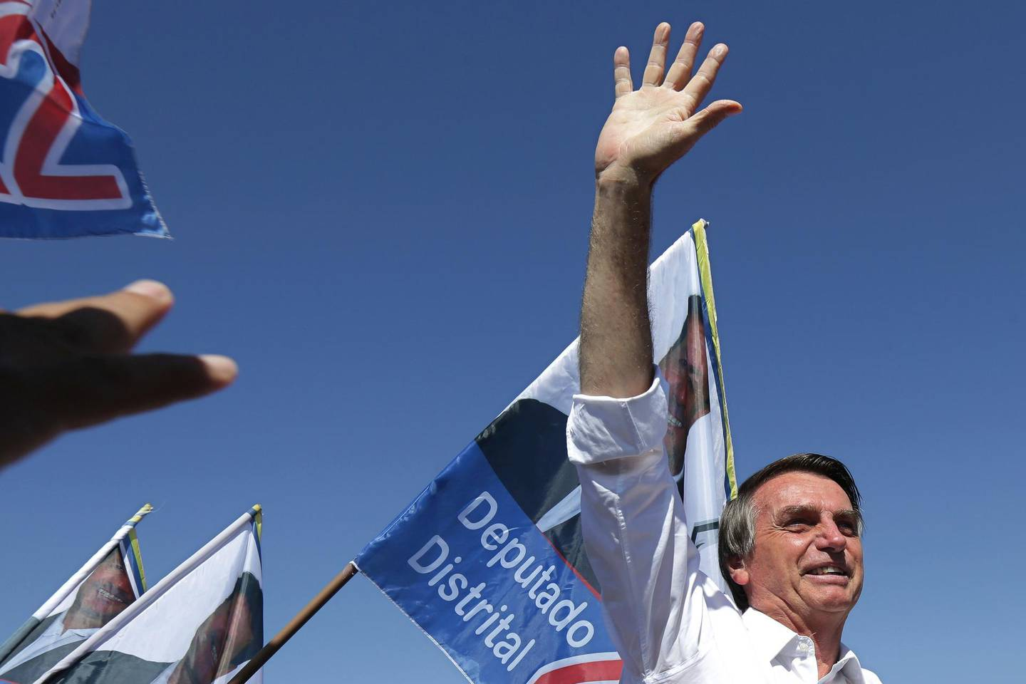 FILE - In this Sept. 5, 2018 file photo, Jair Bolsonaro, National Social Liberal Party presidential candidate, greets supporters during a campaign rally in Brasilia, Brazil. Now that former President Luis Inacio Lula da Silva has been bumped off the ballot for a corruption conviction, Bolsonaro is leading in the polls, apparently with the aid of evangelical backers. (AP Photo/Eraldo Peres, File)